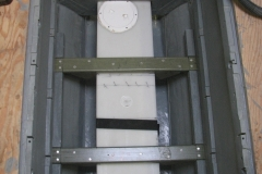 View of grey water tank from the top. The crossmembers are fiberglass u-channel extrusions. They hold the tank in place while also supporting the fuel tank above it