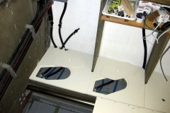 base cabinets with fuel tanks and plumbing exposed underneath