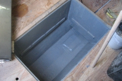 Center water tank / battery box compartment