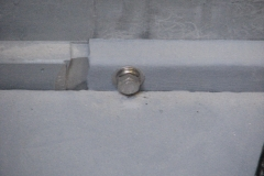 Closeup of the one of the securing bolts.